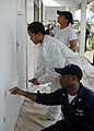 US Navy 091020-N-8607R-102 Sailors assigned to the amphibious assault ship USS Bonhomme Richard (LHD 6) paint a middle school during a community service project in Manatutu, Timor-Leste.jpg
