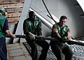 US Navy 091121-N-1291E-219 Aviation Structural Mechanic 3rd Class Obidiah Mutua, left, and Aviation Electronics Technician Airman Anthony Skubon help pull in the electrical cables, or the mag-tail, of a MK-105 Mod 4 Sled.jpg
