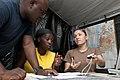 US Navy 100207-N-5712P-022 Sailors assist a Haitian citizen seeking aid from the Civil Military Operation Center.jpg
