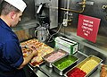 US Navy 100327-N-3595W-012 Cytological Technician Technical 1st class Matthew Pavlik prepares fresh pizza for crewmembers aboard the guided missile destroyer USS Carney (DDG 64) as part of a First Class Petty Officers Associati.jpg