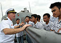 US Navy 100527-N-7643B-114 Lt. j.g. David Kellen explains the capabilities of the 76mm (3-inch)-62 caliber MK 75 rapid-fire gun to a group of Indonesian high school students aboard the guided-missile frigate USS Vandegrift (FFG.jpg