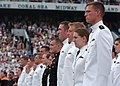 US Navy 100528-N-7029R-098 Midshipmen stand at attention as the guest speakers take the stage during the U.S. Naval Academy 2010 graduation and commissioning ceremony.jpg