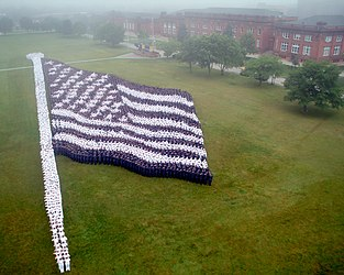 US Navy 100614-N-1894S-095 In preparation for the 2011 Great Lakes Centennial, more than 7400 staff and students from Naval Station Great Lakes recreated the Living Flag from 1917 on National Flag Day at Ross Field.jpg