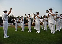 The U.S. Naval Academy Band performing the U.S. national anthem on the field of Prince George's Stadium.