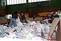 US Navy 110624-N-ZZ999-045 Volunteers from Misawa Air Base sort and bag clothes donated to Japan by listeners of the Seattle area.jpg