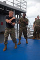 US Navy 111009-A-WF228-070 Sgt. Jonathan Benezette demonstrates a fighting stance during Marine Corps martial arts training aboard the amphibious d.jpg