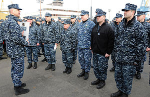US Navy 120111-N-GU530-027 Capt. Paul Skarpness, commander of Submarine Squadron (SUBRON) 17, congratulates the Blue and Gold crews of the ballisti.jpg