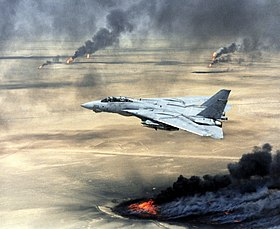 US Navy F-14A Tomcat flying over burning Kuwaiti oil wells during Operation Desert Storm.JPEG