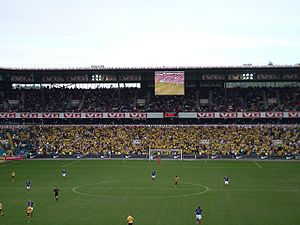 """Lillestrøm SK - The supporters of Lillestrøm, """"Kanari-fansen"""". From a match between Lillestrøm and Vålerenga at Ullevaal Stadion in 2006."""