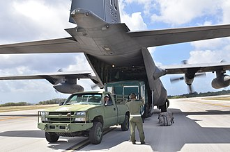 Commercial Utility Cargo Vehicle - Image: Unloading a CUCV vehicle and a trailer from a C 130H Hercules