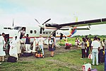 Unloading goods at el Real grass airport.jpg