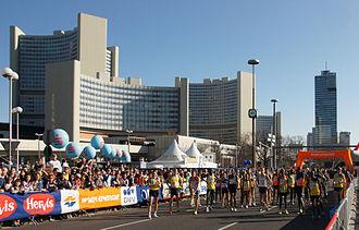 Vienna City Marathon - Top athletes approaching starting line. In background: Vienna International Center.