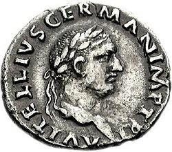 Grey coin depicting a male face staring right