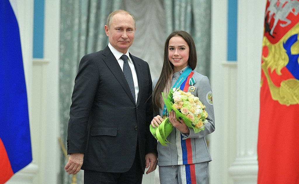 https://upload.wikimedia.org/wikipedia/commons/thumb/a/a0/Vladimir_Putin_and_Alina_Zagitova_%282018-02-28%29.jpg/1024px-Vladimir_Putin_and_Alina_Zagitova_%282018-02-28%29.jpg