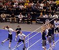 Volleyball kill shot three blockers.jpg