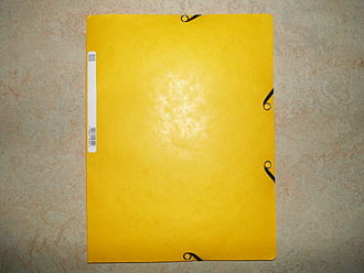 File folder - A yellow file folder made of paper.