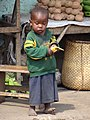 Young Boy with Banana - Outside Kabale - Southwestern Uganda (7622685286).jpg