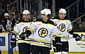 Zach Hamill with Jeremy Reich and Jordan Caron- P-Bruins.jpg