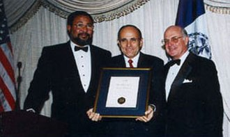 The Hundred Year Association of New York - Former Mayor Rudolph W. Giuliani receives the association's 1998 Gold Medal Award, presented by Time Warner President Richard D. Parsons and Former Association President Richard A. Cook.