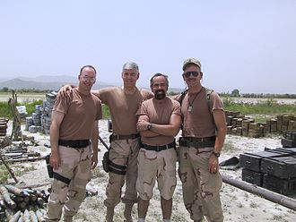 Forward Operating Base Chapman - U.S. Army Soldiers and contractors pose for a photograph at FOB Chapman in July 2002.