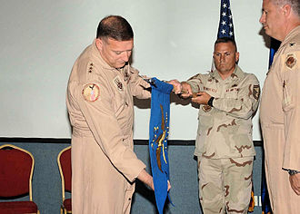 363d Intelligence, Surveillance and Reconnaissance Wing - To activate the 363d Training Group in an official ceremony on 26 March 2007, U.S. Central Command Air Forces Commander Lt Gen Gary North unfurls the unit colors as Col Michael Cosby, right, stands ready to assume command.