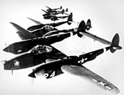 4 Lockheed P-38 Lightnings in formation