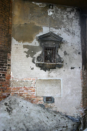 """Excommunication - Plaque on exterior of the Chiesa della Pietà in Venice, the church of the orphanage. This is where the foundling wheel once stood. The inscription declares, citing a 12 November 1548 papal bull of Pope Paul III, that God inflicts """"maledictions and excommunications"""" on all who abandon a child of theirs whom they have the means to rear, and that they cannot be absolved unless they first refund all expenses incurred."""