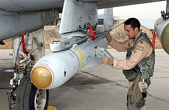 Air-to-surface missile - A pilot inspects an AGM-65 Maverick missile on his A-10 Thunderbolt II.