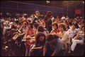 AUDIENCE SETTLES DOWN FOR CONCERT BY SINGER JUDY COLLINS AT CENTRAL PARK'S SCHAEFER BANDSTAND - NARA - 551675.tif