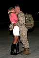 A U.S. Marine with Marine All-Weather Fighter Attack Squadron 224 kisses a loved one after a six-month deployment to the Western Pacific in Support of the Unit Deployment Program aboard Marine Corps Air Station 130322-M-EK666-005.jpg