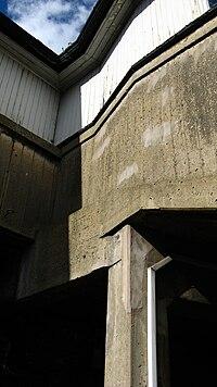 A concrete railway pedestrian overbridge