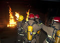 A group of multinational sailors extinguish a fire during a firefighting training exercise at the Norfolk Farrier Firefighting School in Norfolk, Va., Aug. 10, 2012 120810-N-YC505-028.jpg