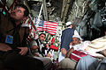 Afghans take their seats aboard a C-130 Hercules aircraft Aug 100825-A-UH396-152.jpg