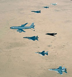 Aircraft of the USAF 379th Air Expeditionary Wing and UK and Australian counterparts stationed together at Al Udeid Air Base, Qatar, in southwest Asia, fly over the desert on April 14, 2003. Aircraft include KC-135 Stratotanker, F-15E Strike Eagle, F-117 Nighthawk, F-16CJ Falcon, British GR-4 Tornado, and Australian F/A-18 Hornet.