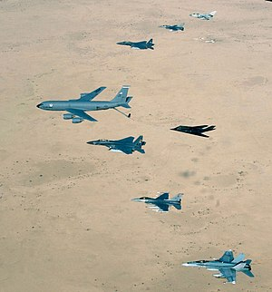 History of the United States Air Force - Aircraft of the 379th Air Expeditionary Wing and coalition counterparts stationed together at Al Udeid Air Base, Qatar, in southwest Asia, fly over the desert. April 14, 2003. Aircraft include KC-135 Stratotanker, F-15E Strike Eagle, F-117 Nighthawk, F-16CJ Falcon, British Tornado GR4, and Australian F/A-18 Hornet.