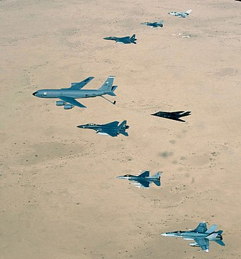 Aircraft of the USAF 379th Air Expeditionary Wing and UK and Australian counterparts stationed together at Al Udeid Air Base, Qatar, in southwest Asia, fly over the desert on 14 April 2003. Aircraft include KC-135 Stratotanker, F-15E Strike Eagle, F-117 Nighthawk, F-16CJ Falcon, British GR-4 Tornado, and Australian F/A-18 Hornet AirForce over Iraq.jpg