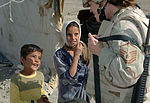 Air Force Master Sgt. Jennifer Smith talks with two Bedouin childre.jpg