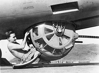 Ball turret - A crewman poses with the Sperry ball turret of a Royal Air Force B-24, Burma, c.1943-1945