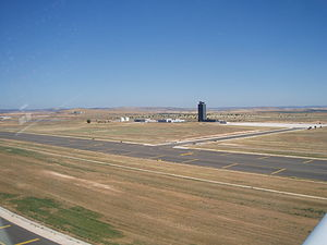 Ciudad Real Central Airport - The control tower and taxiway as seen at take-off