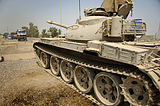 An Iraqi Army T-55A tank parked in front of a checkpoint.JPG