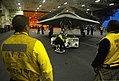 An X-47B unmanned combat air system is towed into the hangar bay of the aircraft carrier USS George H.W. Bush (CVN 77) in the Atlantic Ocean May 13, 2013 130513-N-FU443-061.jpg