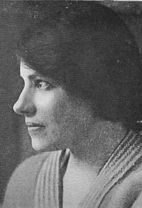 Profile of the head and far shoulder of Anderson in her twenties. She has a prominent nose and mouth and a serious expression. Her one visible eye looks intently into the light. She is dressed plainly and her hair is gathered behind her head.