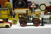 Antique tin toy horseless carriage (25606121395).jpg