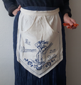 Apron with pockets for clothes pegs.png