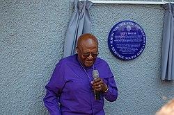 Photo of Desmond Tutu, Leah Tutu, and John Noero blue plaque