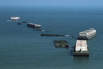 Mulberry harbour - The remains of the harbour off Arromanches in 1990