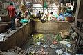 Assembling garlands at City Market, Bangalore in May 2008.jpg