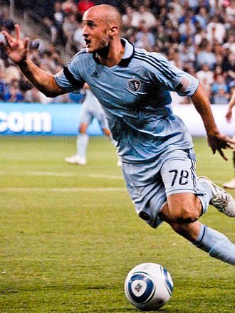 Sporting Kansas City - Aurélien Collin wearing Sporting's primary uniform (2011–2012)