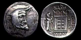 Ardashir I - Coin of Otofradat I; the picture behind the coin is a structure similar to Ka'ba-ye Zartosht.