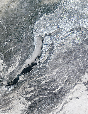 Geography of Russia - Lake Baikal. Lake ice is beginning to form at the northernmost end of the lake and in a bay at the middle.